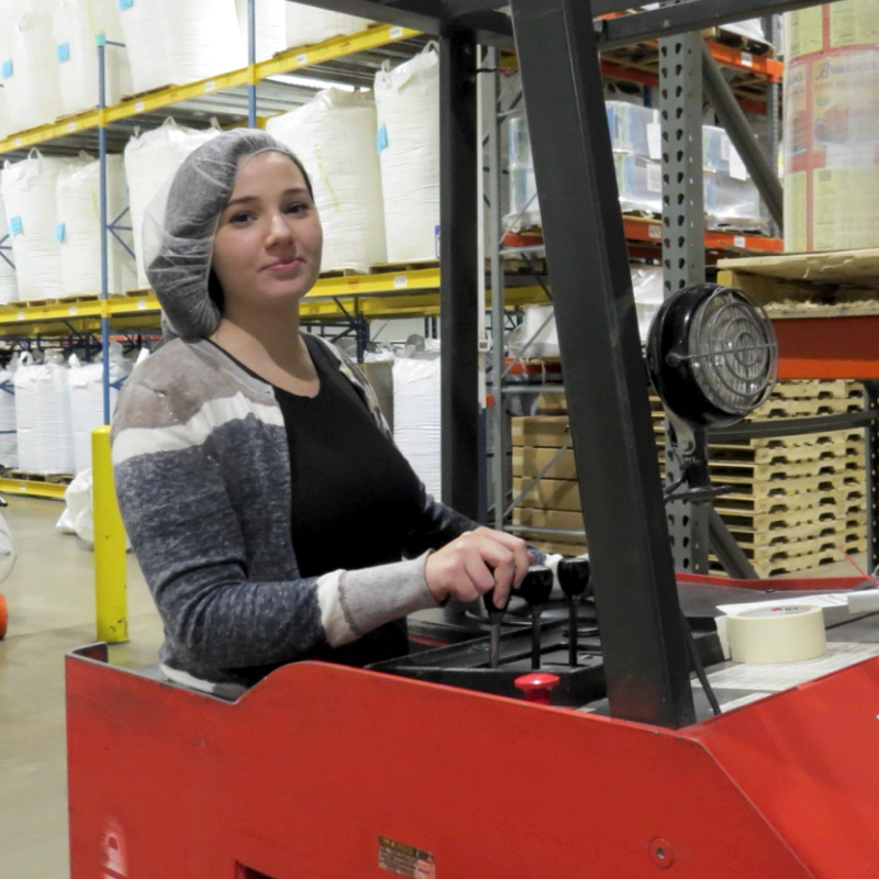 Featured employee Dakota McCall drives a forklift in the TVS warehouse.