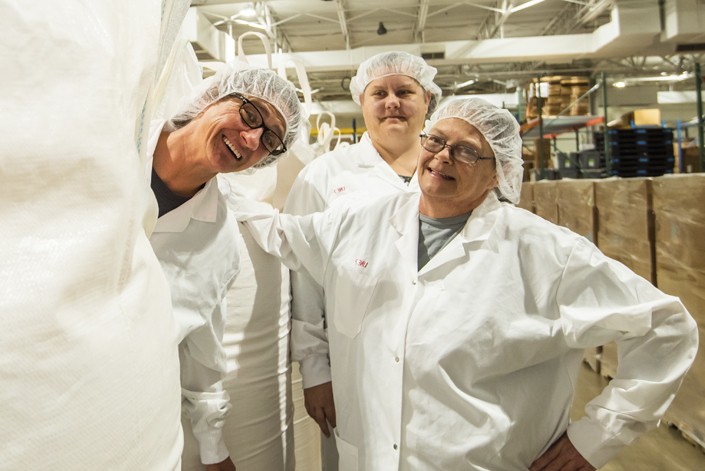 Employees blending ingredients for Mountain Maid products.