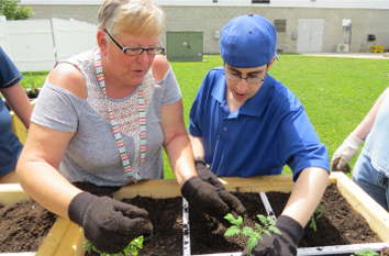 Adult developmental vocational program participants learn about nature and gardening.